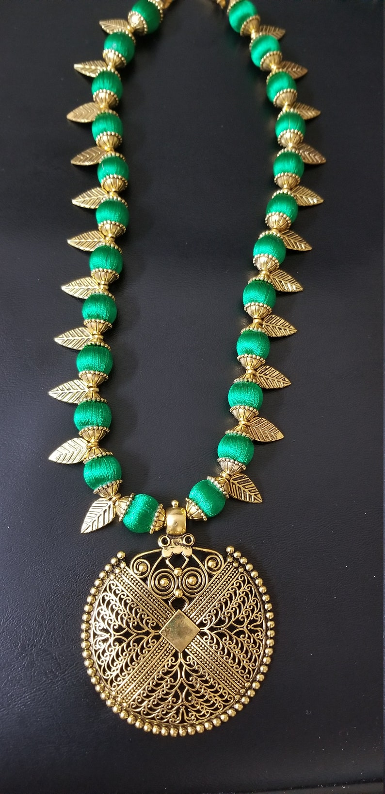 Indian Fashion Jewelry MK Fashionkart Antique finish pendent with green silk thread beads and Antique leaves