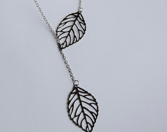 Silver plated necklace with asymmetrical leaves.