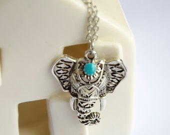 Ethnic necklace, featuring a silver and turquoise elephant pendant.