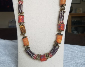 African authentic hand painted kobo trading beads and brass ethnic necklace.  24 inches long