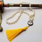 Wisdom Eyes of the Buddha mala - 54-bead, hand-knotted 8mm natural shell beads with tagua guru bead, silk tassel