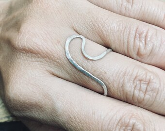 Handmade sterling silver ring in the form of a wave for a salty soul.
