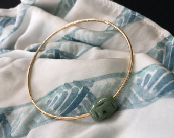 14k gold filled bangle in 14 gauge with greenish jade bead