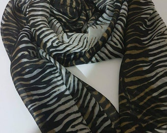 4 different scarves with size 200x50cm. 100 % pure silk