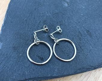 Circle drop earrings.