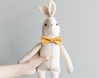 plush bunny-shaped with yellow bow and red tie. Custom
