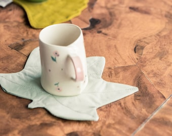 cotton coasters in the shape of autumn leaves in various colors