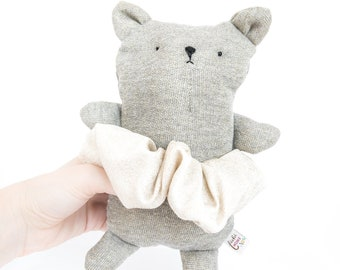 grey and gold plush bear with scarf or skirt