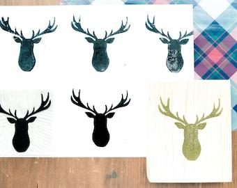 Christmas stamp deer head to decorate tickets, invitations, menus, pack packages.