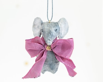 Vintage-inspired hanging decoration. Elephant with purple bow in cotton yarn. Custom.