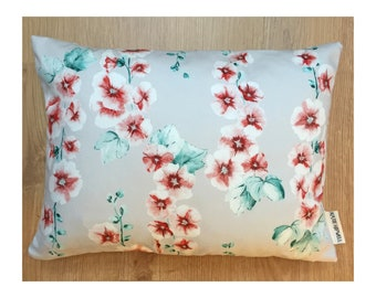 Floral cushion in hand-painted Hollyhock Coral print fabric