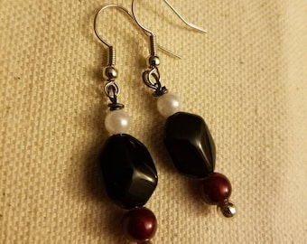 Black, red, and white dangle earrings
