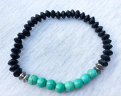 Turquoise and Black Brace...