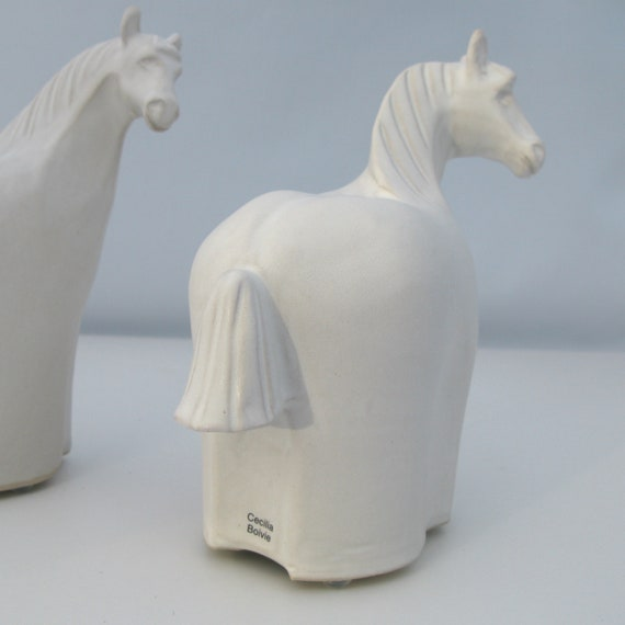 Sculpted Ceramic Horse Black and White Each peice is unique and made by my self Handmade from stoneware clay