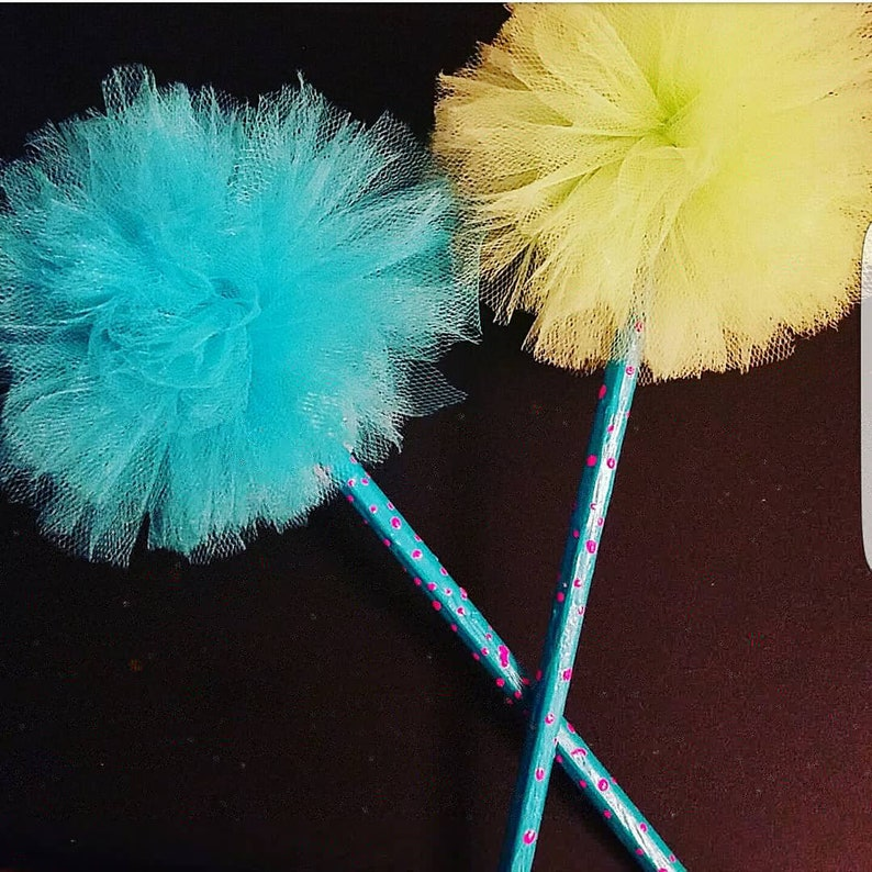 turquoise and lime green pencils with tulle pom pom toppers
