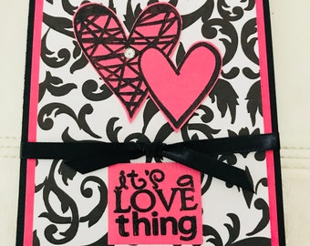 It's a love thing in pink, black and white for anniversary
