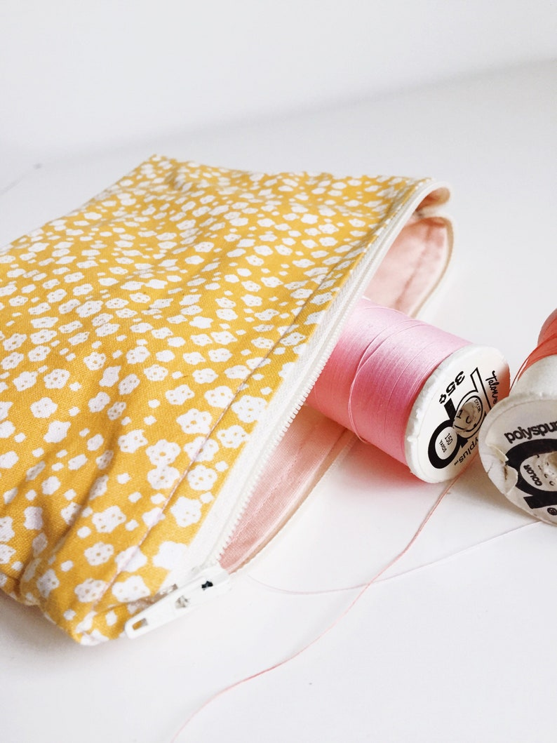 White and Yellow Flower Travel Pouch