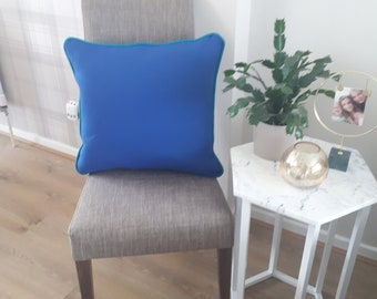 Blue Handmade piped cushion.