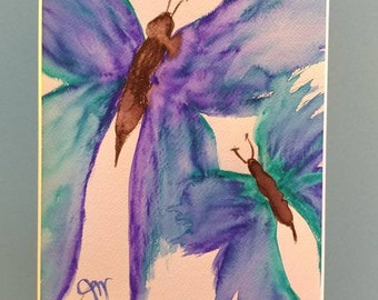 Watercolor butterflies in blue and greens with a robin blue egg mat