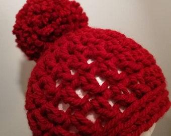 77763b9f9e557 Chunky red giant pom pom hat