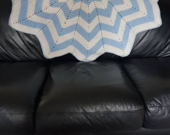Hand crocheted 12 point star blanket.