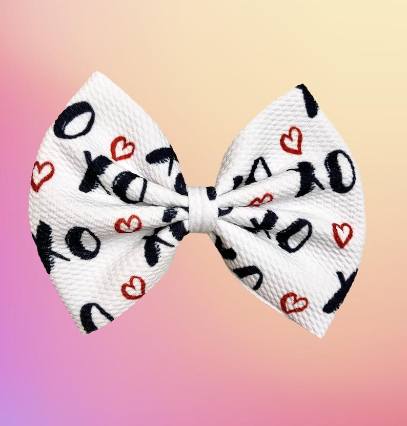 Valentine\u2019s Day bow on nylon Valentine\u2019s Day bow on clip Valentine\u2019s Day bow Xoxo Valentine\u2019s Day heat bow
