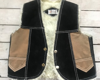 Genuine leather and sherpa vest