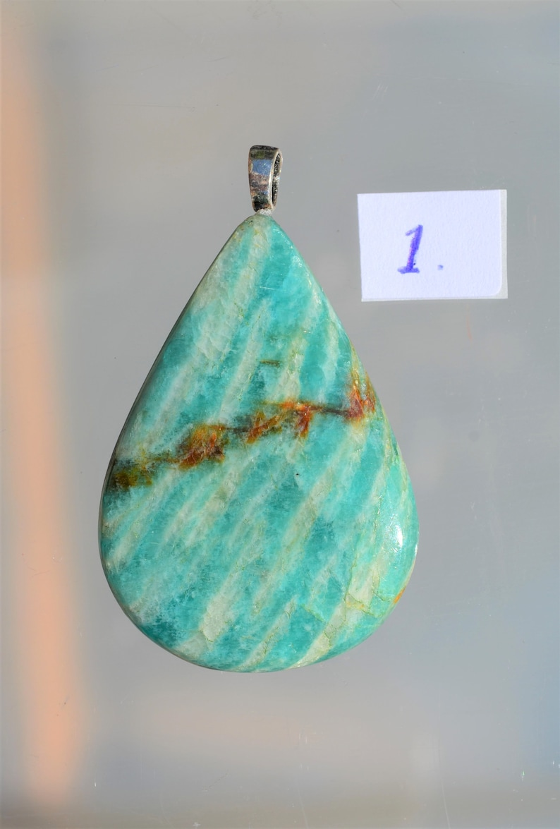 Beautiful drop-shaped cut gemstone from Amazonite as a necklace with a sterling silver pendant eye. semi
