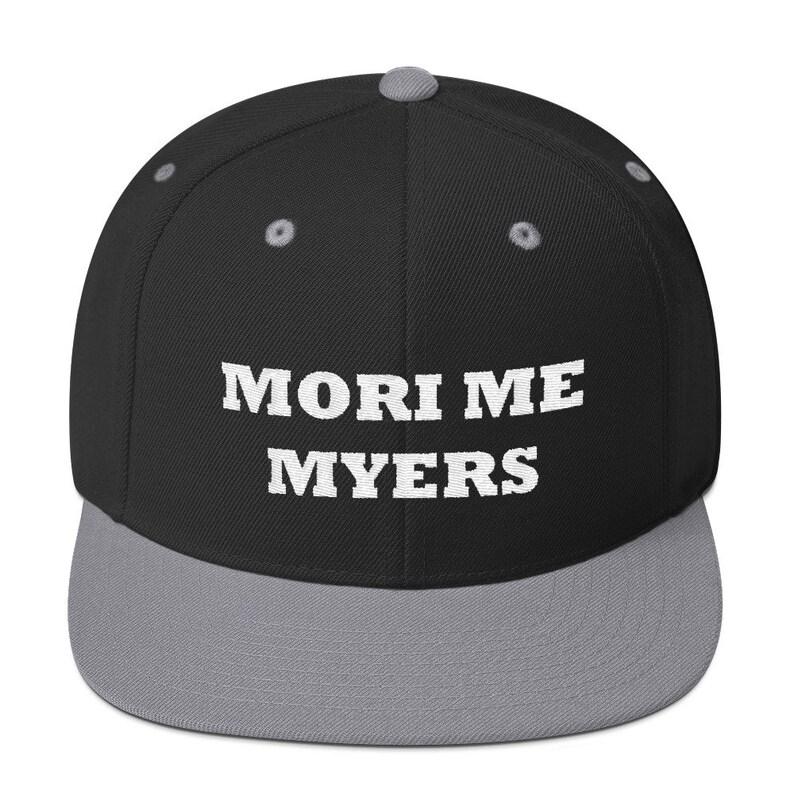 209d9fefa0da0 Mori Me Myers Embroidered Snapback Hat    DBD Halloween