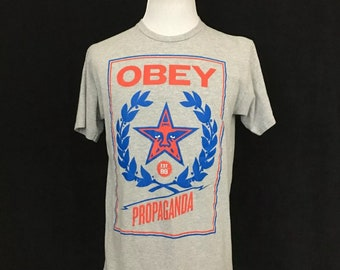 87bfdcdd193 Vintage 1980 s Obey Propaganda Graphic T-Shirt Size Large Short Sleeve Gray