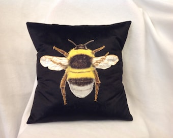 Handmade black velvet bee cushion