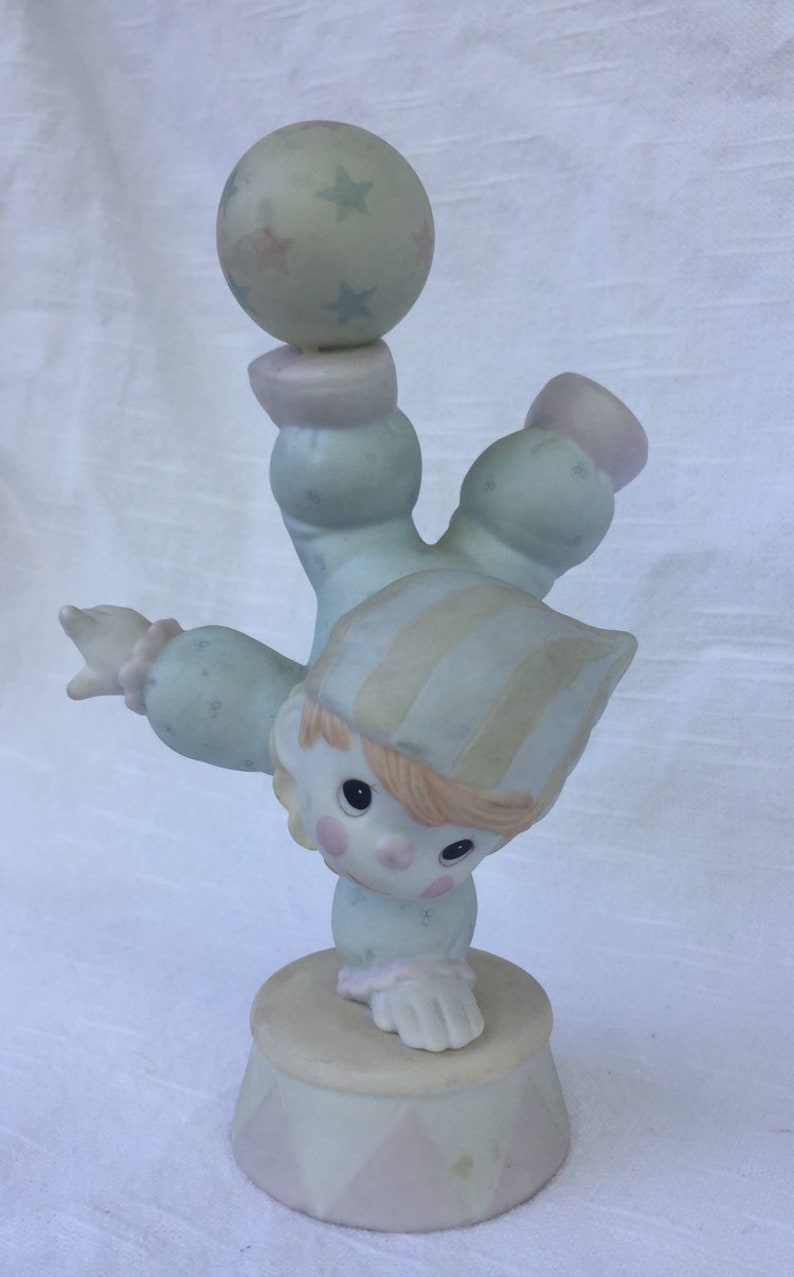 Vintage 1980s Precious Moments Smile Along The Way figurine.