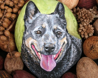 Portrait of an Australian Cattle Dog on a flat river rock custom painted