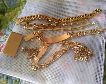 285 grams @ 10.0530792 ounces of gold plated and gold filled jewelry_chains, medallion and rings