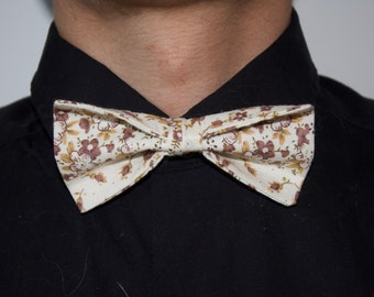 White floral patterned bow