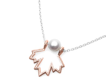 Souvenir from a trip to the Canada. Leaf recycled 14 k rose gold. Freshwater Pearl