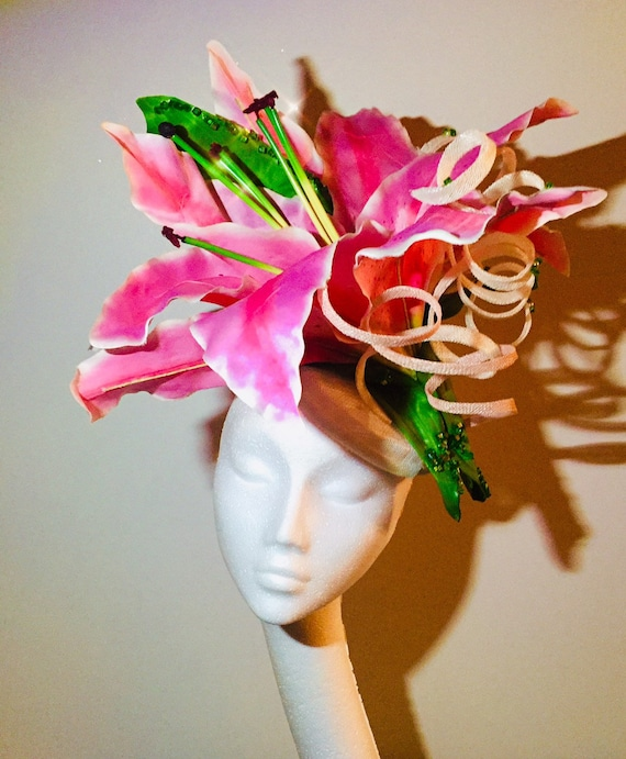 Giant pink lily flower fascinator on a white button base with  b4f9c50bcd3