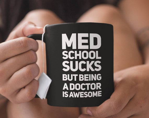 Med student mug med sucks school but being a doctor is awesome black coffee cup