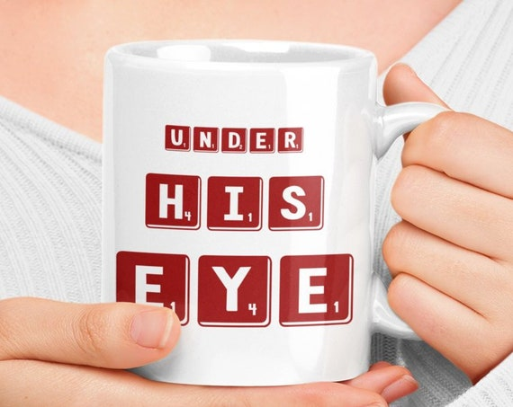Under his eye coffee mug tea cup