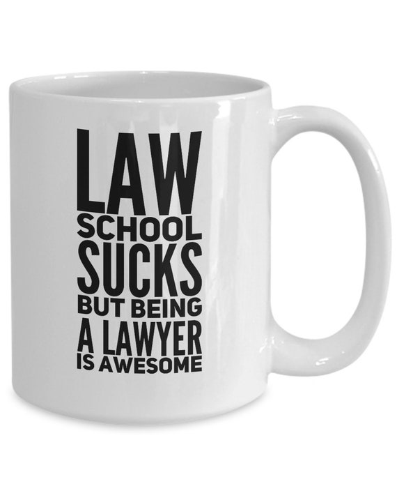 Law student mug law school sucks but being a lawyer is awesome