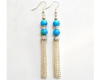 Daisy - These teal earrings with tassels