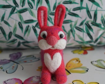 Needle felted pink and purple bunny, with big white heart and fluffy nose. Perfect gift for yourself and your friends.