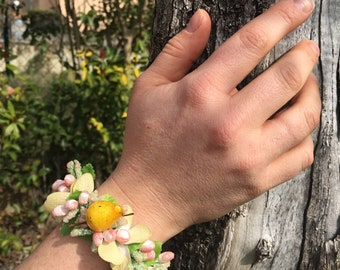 Yellow pear bracelet and flowers