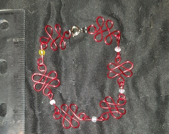 Red wirework bracelet with white beads