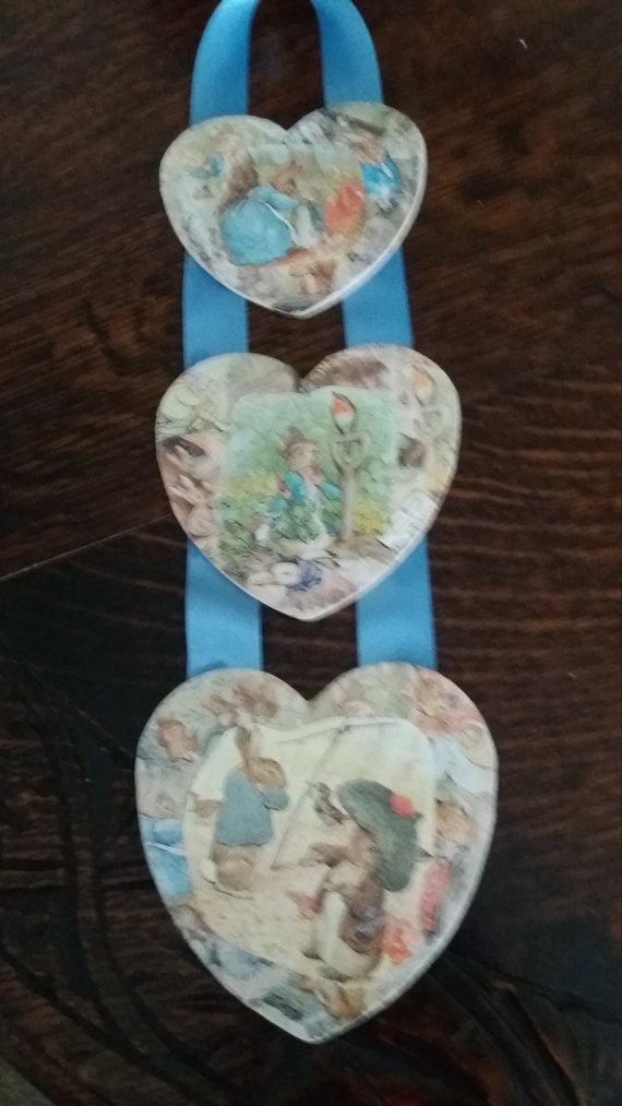 Peter Rabbit decoupaged triple wooden hanging heart set. Featuring Beatrix  Potter characters. Perfect for a nursery