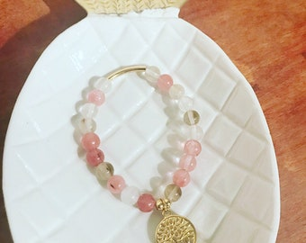 Bracelet made of cherry quartz beads + tree of life stainless steel charm