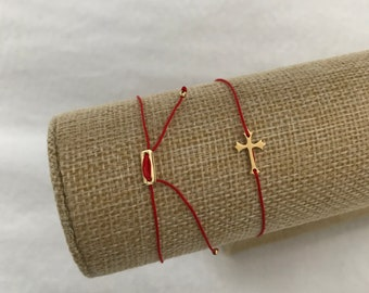 Gold cross with red string