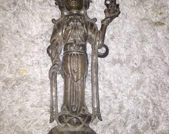 Antique bronze statue
