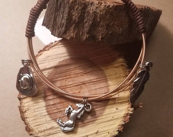 Guitar string bracelet with charms