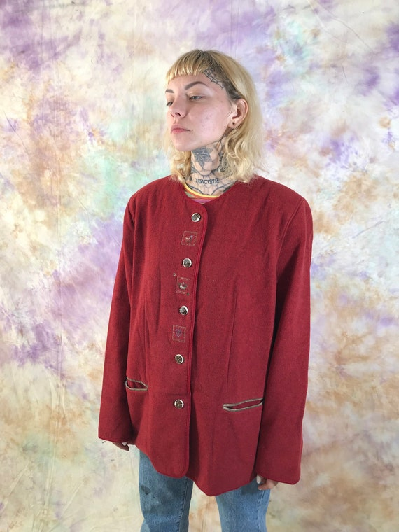 Vintage women's woolen jacket with embroidery. Lar